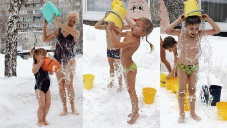 детки и взрослые обливаются водой